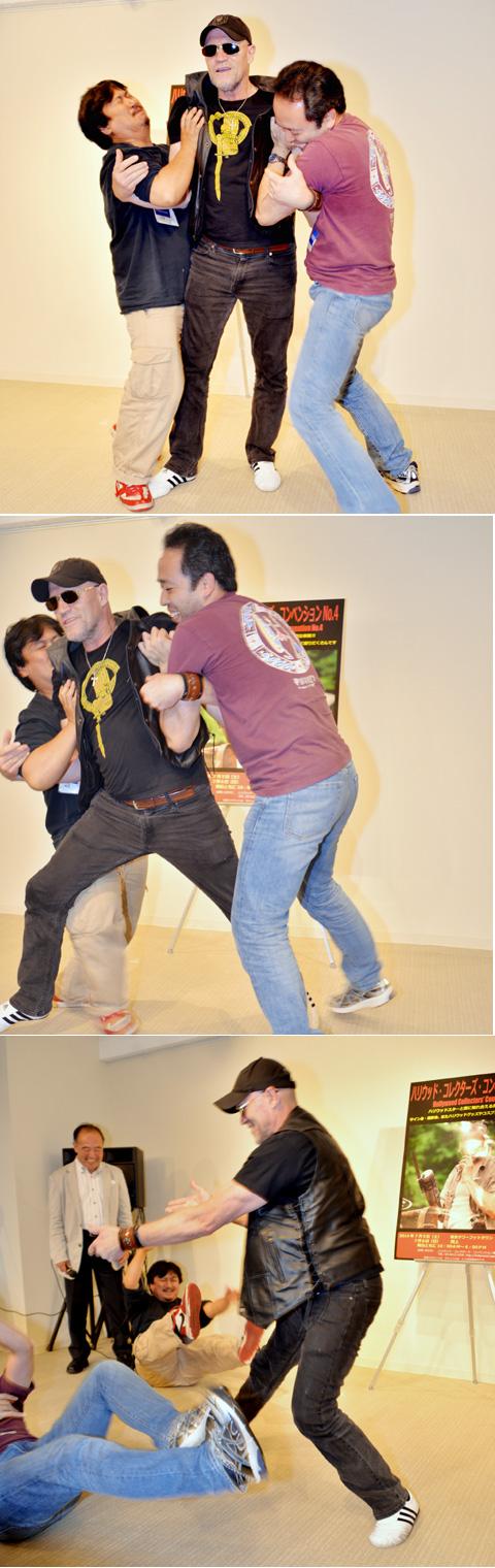 (写真上)体格のいい記者2人がマイケルを持ち上げようとするも全く持ち上がらない (写真中央)マイケルが態勢を変えると... (写真下)2人の記者はいとも簡単に投げ飛ばされてしまった
