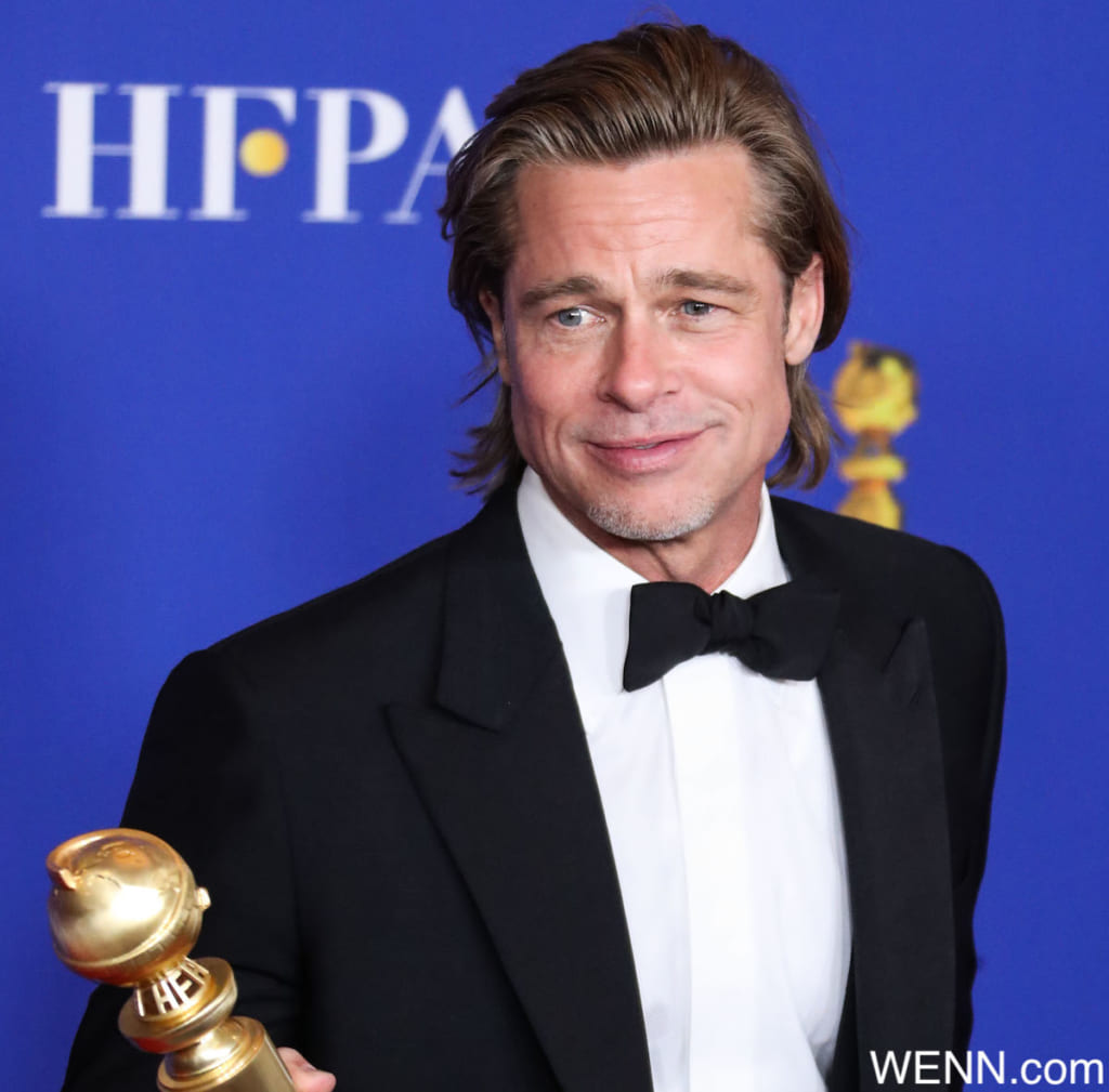 Actor Brad Pitt wearing a Brioni tux poses in the press room at the 77th Annual Golden Globe Awards held at The Beverly Hilton Hotel on January 5, 2020 in Beverly Hills, Los Angeles, California, United States. Where: Beverly Hills, California, United States When: 05 Jan 2020 Credit: WENN/Avalon **WENN/Avalon**