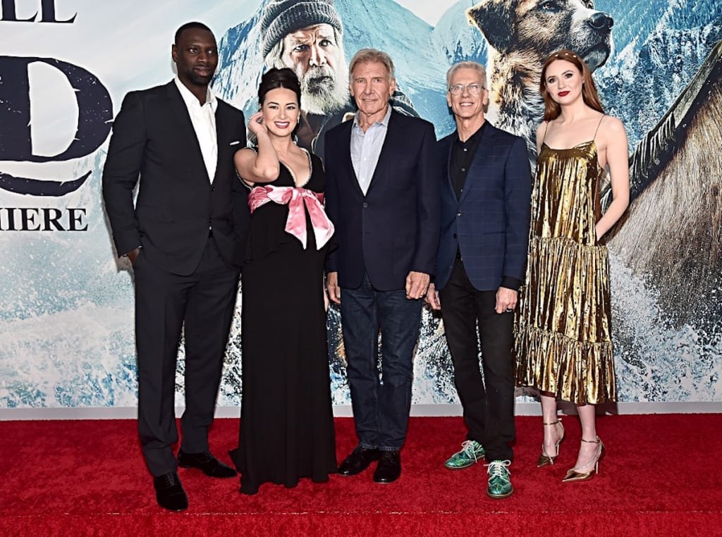 HOLLYWOOD, CALIFORNIA - FEBRUARY 13: Omar Sy, Cara Gee, Harrison Ford, Director Chris Sanders and Karen Gillan arrive at the World Premiere of 20th Century Studios'